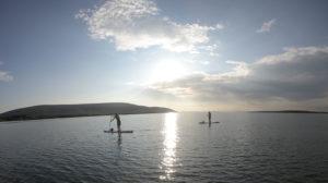 People paddleboarding on Galway Bay near Kinvara
