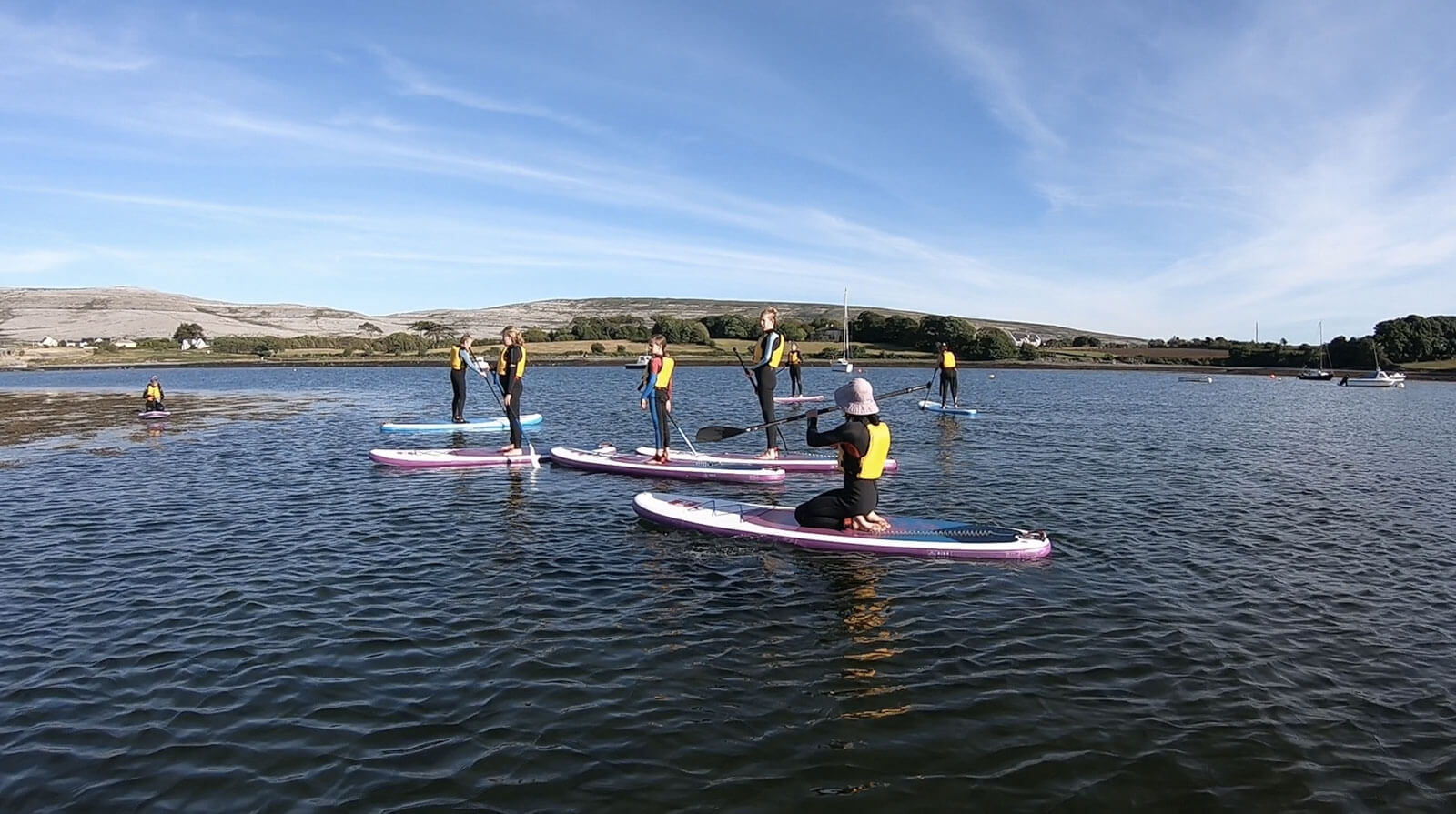 Family with Stand Up Paddleboarding School